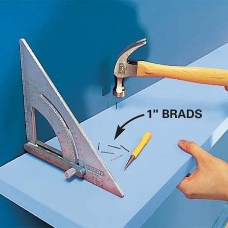 <b>Photo 8: Secure the shelf</b></br> Nail the shelf to the cleat using a square as your guide. Start at the middle and work your way to each end. Use 1-in. brad nails spaced 8 in. apart.