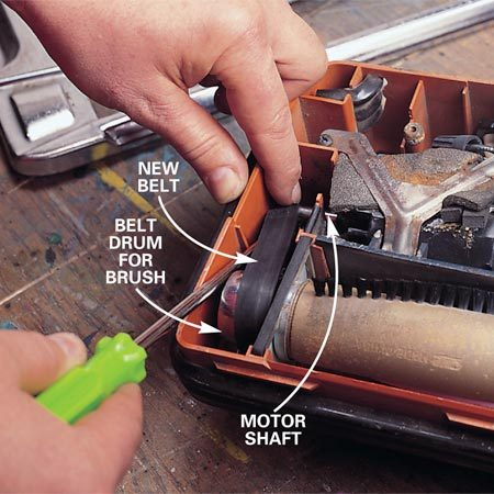 <b>Photo 2: Replace the belt</b></br> Remove the broken drive belt and study how the belt connects the motor shaft with the brush's drum. Some models require you to pull out the brush to attach a new belt (our model didn't). Install a new drive belt by first threading it around the drum. Using a large straight-slot screwdriver, pry the other end of the belt around the motor shaft's roller. Spin the drum by hand to check the tension, then reinstall the cover plate.