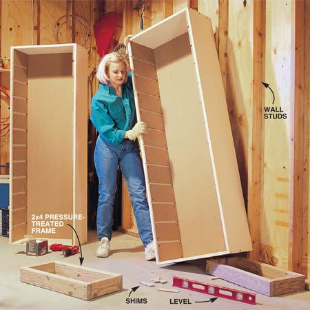 <b>Photo 5: Cut and assemble the frame</b></br> Cut and nail together a  2x4 frame for each tower. Position the frames, level them using shims and screw them to the wall with 3-in. screws. Then tip each tower onto a frame. Fasten each tower to wall studs with at least four 2-in. drywall screws.