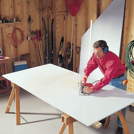 <b>Photo 1: Cut the plywood</b></br> Cut the plywood to the dimensions show in Fig. B, below. The cuts don't have to be precise; you don't need a saw guide. Wear goggles and hearing protection.