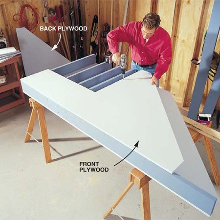 <b>Photo 3: Install the front piece</b></br> Lay the front plywood piece over the 2x6s and anchor it with 2-in. screws driven every 12 in.