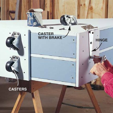 <b>Photo 6: Attach the casters</b></br> Attach the four casters and the strap leaf of the hinges with 1/4 in. x 1-1/2 in. lag screws. Place the caster with a brake on the outer front edge of the rack to hold the rack stationary when sliding items in and out.