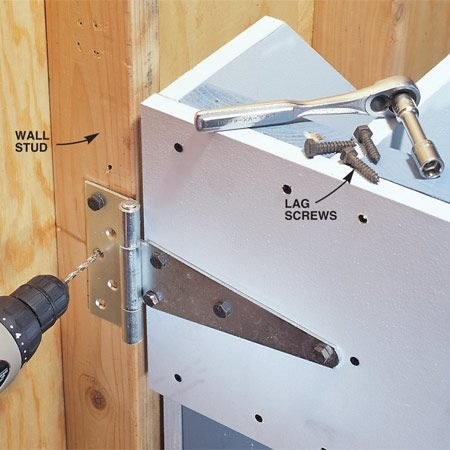 <b>Photo 7: Fasten the rack to the wall</b></br> Predrill pilot holes and fasten the rack to the wall stud with 1-1/2 in. lag screws.