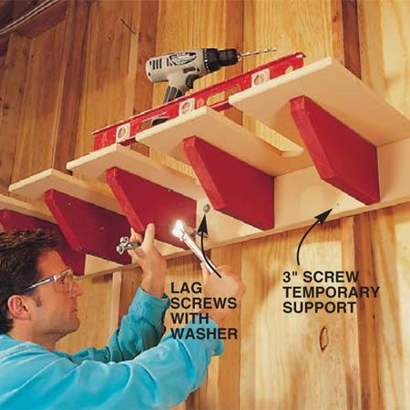 <b>Photo 3: Install the rack</b></br> Level the back against a wall and attach it to the studs with 3/8-in. x 4-1/2 in. lag screws and washers. Predrill holes with a 5/16-in. bit.