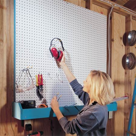 <b>Pegboard wall and bin</b></br> This pegboard wall and bin help keep your garage tidy.