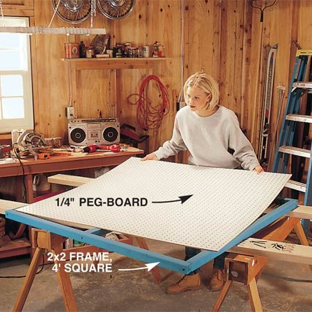 <b>Photo 1: Assemble the pegboard and frame</b></br> Cut and fasten the 2x2 frame with 3-in. drywall screws. Then screw the pegboard to the frame using 1-in. drywall screws.
