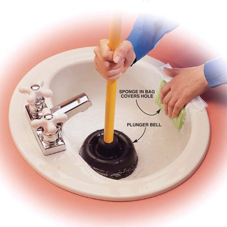 <b>Photo 2: Work the plunger</b></br> Fill the sink with at least 2 in. of water, cover the drain with the plunger bell so the edges seal, and push in and pull out, forcing water up and down in the drainpipes. Seal the overflow hole(s) with a wet sponge or plastic to maintain the pressure.