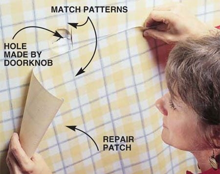 <b>Photo 1: Match patterns with new paper</b></br> Cut an oversized swatch of leftover wallpaper and position it over the damaged area so it extends at least 6 in. in all directions beyond the damaged area. Match the patterns. This extra space allows adequate area for feathering out joint compound around the hole repair.