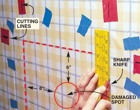 <b>Photo 2: Cut the patch</b></br> Cut the new patch oversize. Then tape the new paper (blue tape) directly over the existing wallpaper so the wallpaper patterns match. To establish the cutting lines, place marked pieces of tape (red tape) on the wall to mark the horizontal and vertical cutting lines. Lay a metal straightedge between these lines. When you cut the new patch, you'll also be cutting a hole exactly the same size out of the old wallpaper.