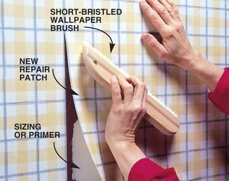 <b>Photo 4: Install the new patch</b></br> Wet the patch (if prepasted) or apply the paste, carefully matching the pattern lines between the patch and the wall (stretch the paper <em>sparingly</em> to fit). Smooth out any air bubbles or wrinkles with long pulling strokes using a short-bristled wallpaper brush. Work the brush from the middle out to the sides. Use a dampened sponge to remove any glue residue or fingerprints.