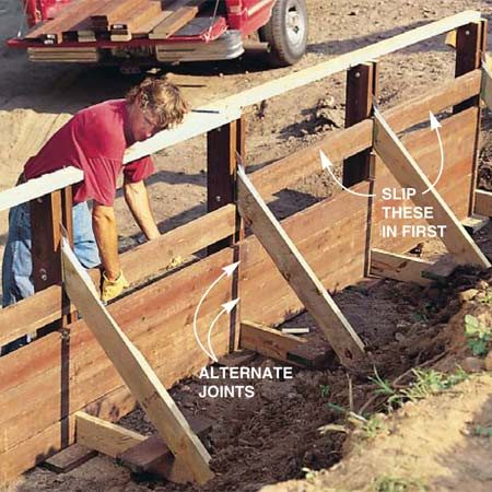 <b>Photo 11: Work planks around braces</b></br> Slip in the planks that fit behind the brace before installing the row directly below it. (It's impossible to put them in later.) Then push that row down into place and nail.