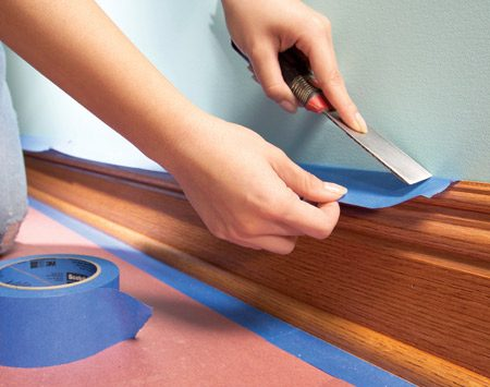 <b>Save time by using wider tape</b></br> <p>Don't waste  time by completely covering baseboard   with several  strips of tape. A single overhanging strip   of wide tape  will catch roller splatters just as the roof   overhang on  your house keeps rain off the siding. Use   1-1/2 in.  tape for narrow baseboard, 2-in. tape for wider   baseboard.  Tape won't stay stuck to dusty surfaces, so   wipe down  all your trim before masking. To minimize   paint  seepage under the tape, press the tape down hard   by running a flexible putty knife over it. </p>