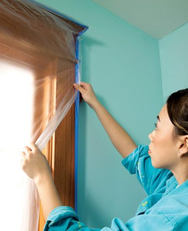 <b>Wide tape provides double-duty protection</b></br> <p>Paint  rollers throw off a mist of paint that speckles   everything  below. Here's the quickest way to protect   doors and  windows: When you tape around door and   window trim  to protect the woodwork, use tape that's   wide enough  to project at least 1/2 in. from the trim.   That way,  you can stick light plastic to the protruding   tape—there's  no need to tape the perimeter of the plastic   separately.  For doors, slit the plastic with a utility   knife so you can walk through. </p>
