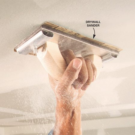 "<b>Use a hand sander and precut sandpaper</b></br> <p>Use a hand  sander ($6), a package of 150-grit drywall   sanding  paper that's precut to fit your sander, and a   sanding  sponge for corners and detail sanding. You'll also   need a  double-strap dust mask rated for nuisance dust   and goggles  to keep the dust out of your eyes. A hat or   scarf to  keep the dust out of your hair is a good idea too.    Sand with  light pressure along the edge of seams and   around  screws to avoid ""fuzzing"" the drywall paper.   Sand the  center of seams just enough to remove ridges   and bumps.</p>"