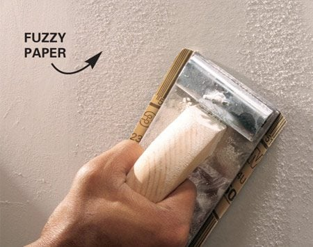 <b>Repriming removes fuzz and lumps</b></br> <p>Sanding  after priming is a critical step that most beginners   skip. But  sanding at this stage removes paper fuzz   and lumps  that will show through your paint job. This is   also the  time to take care of other imperfections by filling   them with  joint compound. Don't forget to sand and   reprime  these touched-up areas or they'll also show   up when you  paint the walls. Prime the walls and sand them   lightly  after the primer dries to remove paper fuzz and lumps.</p>