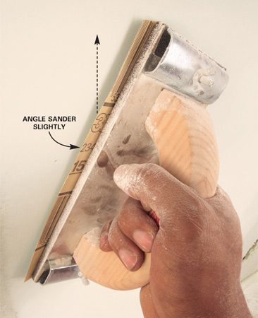 <b>Angle the sander slightly</b></br> <p>Keep the  sander angled slightly.    Press  lightly and avoid scrubbing    back and  forth in one spot.   Don't sand  over electrical   boxes or  other openings.   The edges of  the box can   rip your  sandpaper, or a   piece of the  paper facing   on the  drywall can roll up   under the  sander and tear   off. Keep a  few inches   away from  electrical box   openings and  touch up   around them  later with a  sanding sponge.</p>