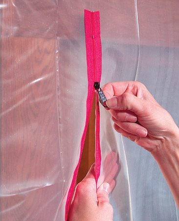 <b>Adhesive-backed zippers let you pass</b><br/><p>If you need  to pass through the dust   barrier, use  heavier 4- or 6-   mil plastic and add an adhesive-backed   zipper. These are available at home centers and  lumberyards. </p>
