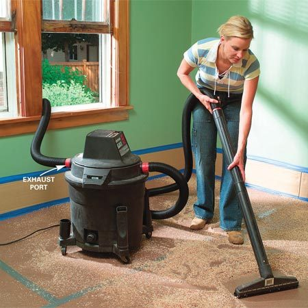 <b>Use extra hose and exhaust outside</b><br/><p>The exhaust  stream from a shop   vacuum can  raise more dust than the   vacuum sucks  up. And small particles (like   drywall  dust) can sail right through the   vacuum  filter to form a fine dust cloud. You   can solve  both problems with some extra   vacuum hose:  Connect a hose to the   exhaust port  and run it outside, or set the   vacuum outside and run the hose inside. </p>