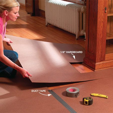 <b>Use hardboard to protect hard flooring</b><br/><p>A hammer  knocked off a ladder can dent hard wood flooring, chip   ceramic tile  or even puncture vinyl, and heavy foot   traffic will  grind grit into the floor. For protection   against  falling tools (and just about everything else),   cut sheets  of 1/8-in. hardboard to fit the room and   duct-tape  them together at the seams. Also tape   around the  perimeter with masking tape so grit can&rsquo;t   get  underneath the hardboard and   scratch the floor. </p>
