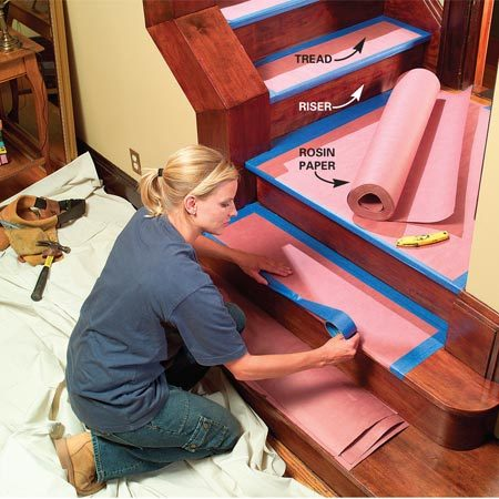<b>Use rosin paper for wood stairs</b><br/><p>Protecting  stairs is tricky   because you  don&rsquo;t want to   use anything  that will cause a slip   or trip.  Rosin paper is a good   choice for  wood stairs because   you can  crease it over the edge of   the tread  and tape it securely   around the  entire perimeter. You   can also  tape separate sheets to   the risers.  For carpeted stairs, use   a long,  narrow dropcloth (called   a runner).  Secure the runner by   driving  small nails right through   the carpet and into the treads. </p>