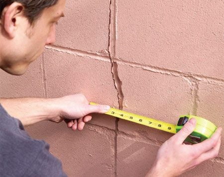 """<b>Measure cracks every few months</b></br> Hairline cracks in a concrete foundation are normal, but cracks that continue to widen spell trouble. They'll eventually cause shifting and cracking in the walls above, tilt floors and move doors and windows so they won't open and close. The movement is glacially slow. To help you spot it, measure and record the gap size. Check it every few months. If the cracks widen, call in a foundation specialist (""""Foundation Contractors"""" online or in the yellow pages) to assess the foundation. Solutions can cost hundreds of dollars, but the cost of ignoring the problem is greater. A major foundation fix can cost thousands."""