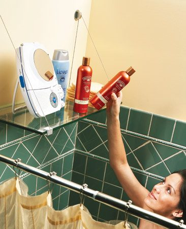 <b>Store shower supplies on a handy shelf</b></br> <p>Tired of the clutter  of shampoo and conditioner   bottles along the  rim of your tub? This tempered   safety glass shelf  on a cable shelf bracket is an easy   solution. The cable  shelf bracket requires only two   screws for support.  If studs aren't located in the right   positions, use  toggle bolts to anchor the shelf brackets.   The glass hangs on  the cables. The cable shelf   brackets (No. CSB5B)  are available online from   <a href='http://www.expodesigninc.com'>expodesigninc.com</a> and cost $21 per pair. Order a   tempered glass shelf  from a local glass company. The   3/8-in.-thick, 12-in.-deep shelf shown here cost $64. </p>