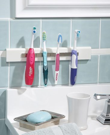 "<b>Use magnets and a Corian mounting strip</b></br> <p>Do your toothbrushes  end up lying on a wet, messy vanity? Here's a   clever solution:   Mount neodymium  (""rare earth"") magnets on a Corian mounting   strip with Super  Glue. Glue the strip to the wall with Super Glue or silicone   caulk.    <strong>Note: </strong>Neodymium magnets are incredibly strong  but break if handled   roughly. Order  several more than you need—shipping is expensive.   Also, don't handle  neodymium magnets if you wear a pacemaker,   and never leave them  next to your computer. For more safety   information, see the ""Neo Mag Safety"" link at <a href='http://www.kjmagnetics.com'>kjmagnetics.com</a>.</p>"
