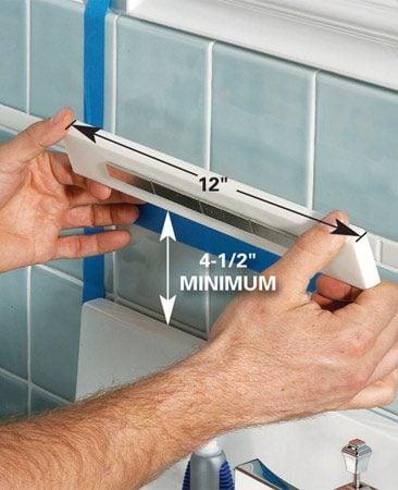 <b>Glue the mounting strip in place</b></br> Glue the mounting strip to the wall with Super Glue, hot-melt glue or silicone caulk.