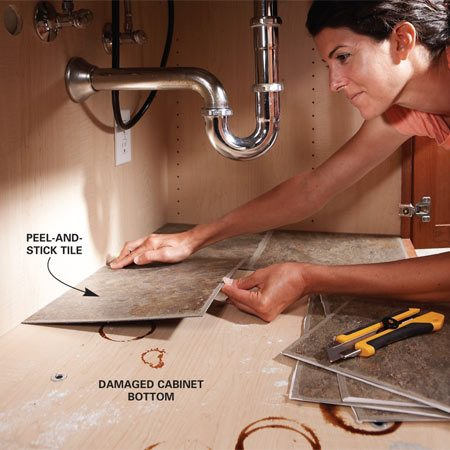 <b>Adhesive tile spruces up storage areas</b><br/>When the floor of your sink cabinet needs a spruce-up, lay down squares of self-adhesive vinyl tile. They're about a buck a square at home centers and provide an easy-to-wipe clean surface.