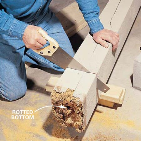 <b>Photo 11: Cut the post to length</b><br/>Measure the height between the house beam and the plinth, subtract 3/16 in. and cut the old basement post to length. Saw a squared bottom from the rotted end, using a circular saw to girdle the post. Finish the cut with a handsaw.
