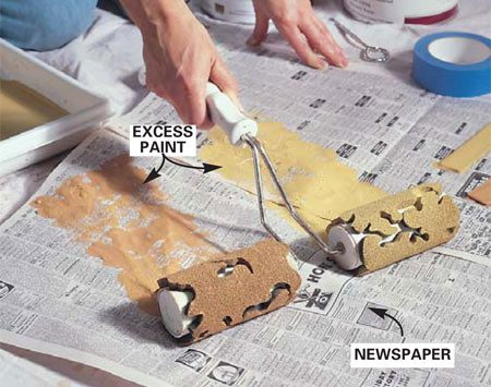 <b>Photo 2: Blot off the excess </b></br> Roll the dual roller onto newspaper to get rid of the excess paint. This will prevent smears or runs on the wall.