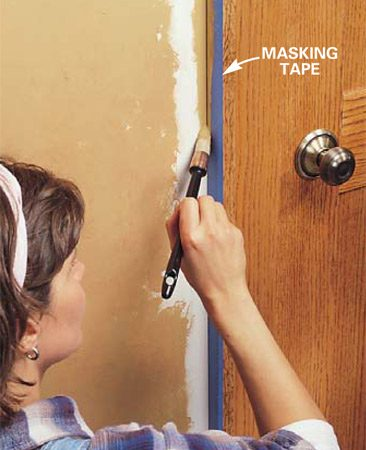 <b>Photo 6: Cut in edges with a brush</b></br> Paint the edges close to door and window trim with a brush. Dab the brush into each color to keep the tones consistent with your walls.