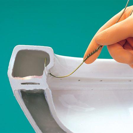 <b>Photo A: Rinse holes</b></br> Clean the rinse holes.