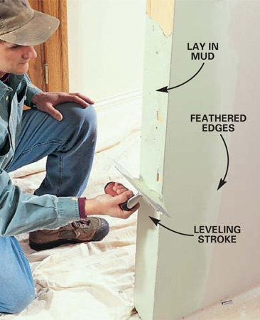 <b>Photo 12: Feather out the corners </b></br> Butter the sides of corner beads, then level and smooth out the mud with the trowel. Fill both sides of the corner beads to the brim of the bead, feathering the outer edges flat to the surface of the drywall.