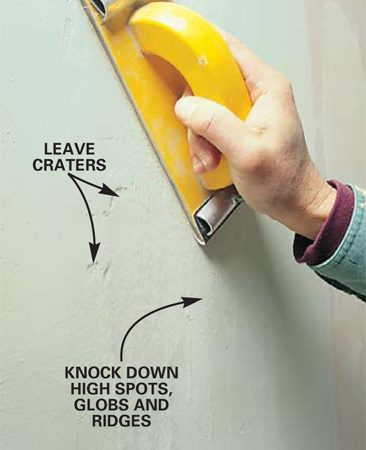 <b>Photo 15: Knock down high spots with a sander </b></br> Knock-off excess dried mud from the edges of corner beads, tool ridges and high spots remaining after the second coat with a drywall sander and 100-grit paper or sanding sponge before beginning the third coat.
