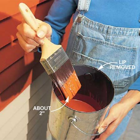 <b>Photo 1: Load the brush</b></br> Load the brush by dipping about 2 in. of the bristles into the paint. Slap the brush back and forth once against the sides of the can to remove excess paint. Paint from a bucket with 2 or 3 in. of paint in the bottom rather than a full can of paint.