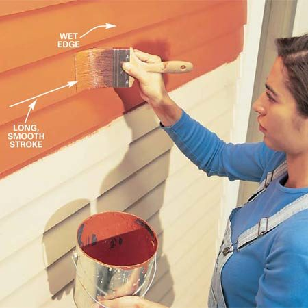 <b>Photo 3: Smooth the paint</b></br> Smooth the paint without reloading the brush. Use long, sweeping brush strokes, working from the unpainted area toward the painted area. Lift the brush while it's still moving at the end of each stroke.