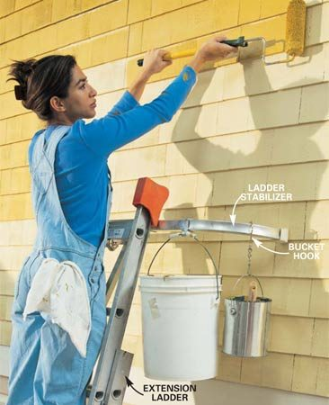 <b>Photo 5: Roll the paint</b></br> Lay on the paint with the roller. Use moderate pressure and reload the roller when paint no longer flows off easily. Again cover about 3 or 4 sq. ft. Rolling causes paint to spatter, so be sure to protect patios, walks and landscaping with dropcloths or plastic.