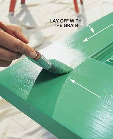 <b>Photo 11: Spread paint, then smooth it</b></br> Spread a layer of paint on the door parts surrounding the panels. Work quickly from one end of the door to the other so you're always brushing back over wet paint. Spread paint on about one-third of the door before smoothing it out with long, sweeping brush strokes. Then move to the next third and brush back toward the finished section. Plan the order to follow the wood grain (see numbers on Photo 10). Don't forget to paint the top and bottom edges of the door to seal out moisture.