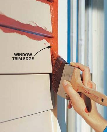 <b>Photo 12: Use the siding color on casing edges</b></br> Paint the edges of window and door casings the same color as the siding. It looks great from the street and will save you tons of time.