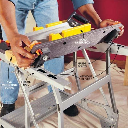 <b>Photo 5: Clamp wide boards</b></br> Attach the rear jaw of this clamping table into a narrower or more open position by inserting the guide bolts into the various keyhole slots. Once locked into rough position, the front jaw can be cranked to pinch objects against the rear jaw.