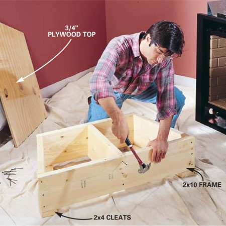 <b>Photo 2: Build a fireplace platform</b></br> Cut 2x10s and nail them together to create an 11-1/2 in. tall platform the shape of the fireplace. Nail 2x4 cleats to the bottom. Cut 3/4-in. plywood to fit and screw it to the top.