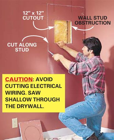 <b>Photo 6: Cut a hole in the wall</b></br> Cut out the 12-in. square hole with a drywall saw and look for obstructions. If there's a wall stud in the way, cut out the drywall between the two closest studs and about 9 in. above the square opening. <strong>Caution:</strong> Keep the saw blade shallow to avoid cutting hidden electrical wires.