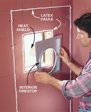 <b>Photo 9: Install the interior firestop </b></br> Replace the insulation and drywall, reusing the old piece if possible. Seal the drywall seams with caulk and place a bead of caulk around the opening. Press the interior firestop into the caulk and screw it to the wall.