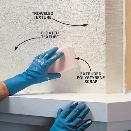 <b>Photo 21: Give the stucco texture</b></br> Rub block of foam insulation in small sweeping arcs over the compound to impart a stucco-like texture. Occasionally clean off texture that builds up on the block. Cut a 45-degree angle on a block to reach into inside corners. Clean up spills and splatters with water before they dry, then move on to the next section.