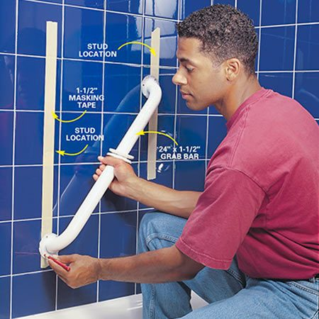 "<b>Photo 4: Place the grab bar over the studs</b></br> Position the grab bar (see ""Positioning Your Grab Bars."") so that at least two of the screw holes align with the studs. Then mark each hole with a grease pencil."