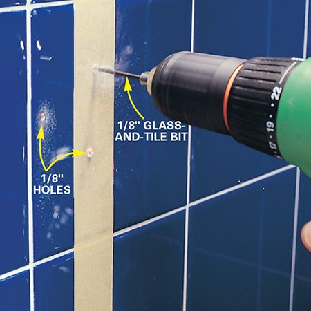 <b>Photo 5: Drill into the studs</b></br> Drill a 1/8-in. hole with a glass-and-tile bit at the mark closest to the center of each stud to confirm the stud location. If you hit solid wood, drill the remaining holes. If not, poke a piece of bent wire through the hole and probe until you feel the stud. Reposition the grab bar and mark the holes