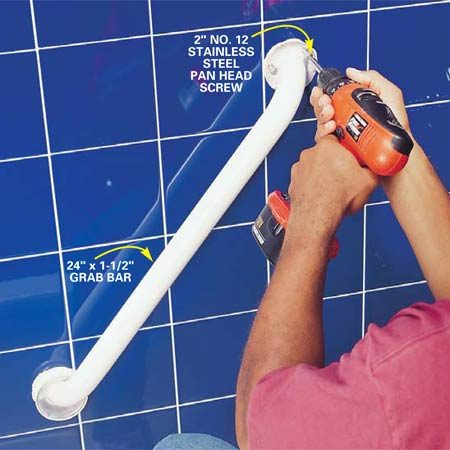 <b>Photo 7: Attach the grab to the wall</b></br> Screw the grab bar to the wall with the No. 10 or 12 stainless steel pan head screws supplied with the grab bar. They should penetrate the stud at least 1 in.