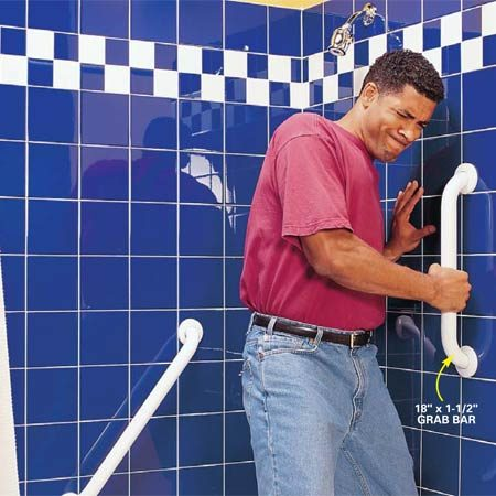 <b>Photo 8: Pull on the bar to see if it's secure</b></br> Attach a vertical grab bar near the tub edge, following the procedures shown in Photos 1 – 7. The bottom of the bar should be about 32 in. to 38 in. above the floor. Yank both grab bars to test for a strong connection.