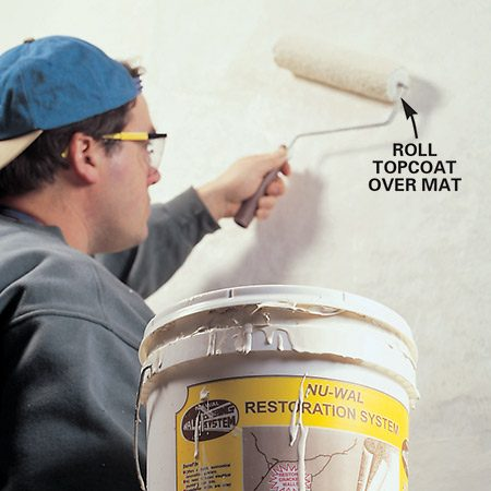 <b>Topcoating the fiberglass</b></br> <p>Roll a special topcoat over the fiberglass mesh if you use the Nu-Wal product; otherwise skim coat the mesh with two coats of joint compound.</p>